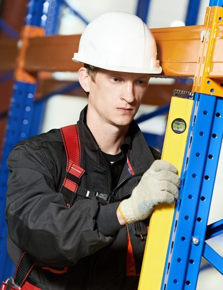 Engineer completing a warehouse pallet racking safety inspection